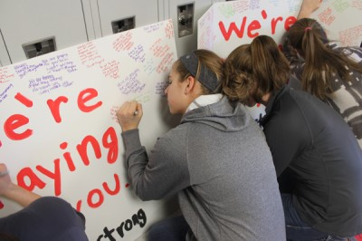 Students sign sympathy cards for Wayzata players