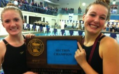 Girls' swimming and diving wins sections, individuals advance