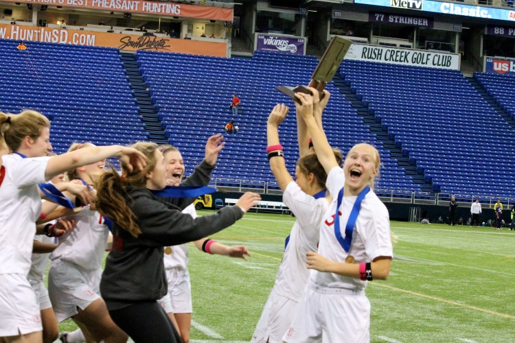 Senior+captains+Anne+Arnason%2C+Dana+Buckhorn%2C+and+Haley+Jerabek--shown+carying+the+girls%27+soccer+State+championship+plaque--lead+their+team+to+the+programs+first+State+