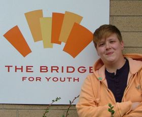 Kristan Clow, outreach manager at The Bridge, reaches out to homeless teens through The Bridge's family reunification model, under which reuniting the youth with family is the first priority.