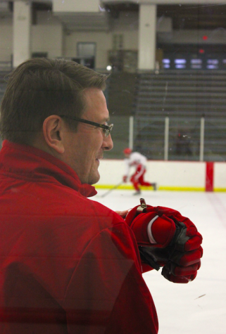 Head boys' hockey coach Ken Pauly presides over practice.