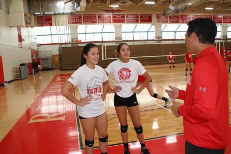 Twin sisters compete side by side on varsity