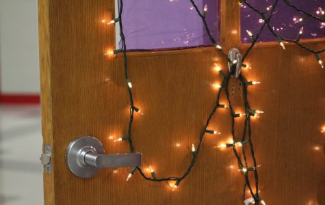 Students decorate homeroom doors in preparation for Advent
