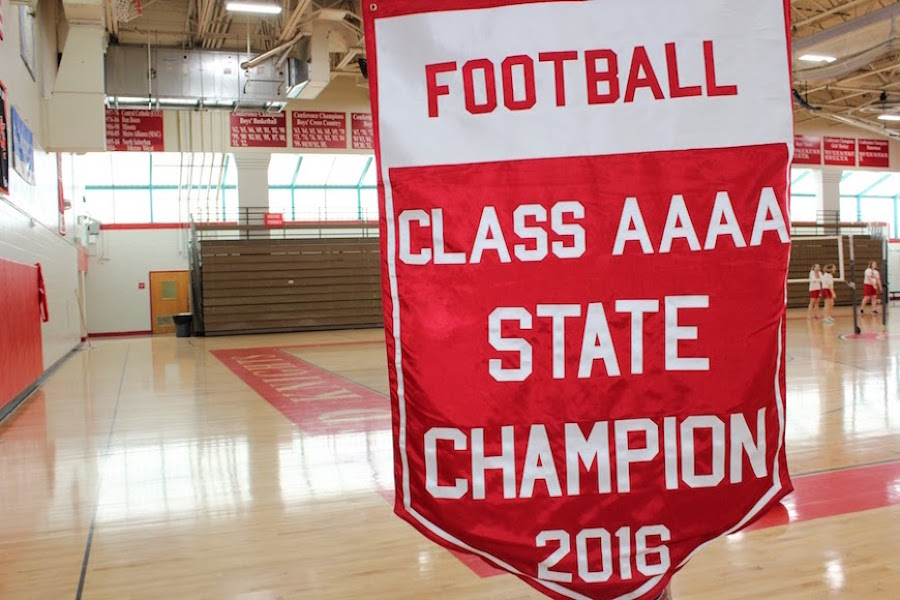 Both the BSM boys football and girls soccer teams became state champions this fall. To commemorate this, banners were hung in the Haben Center during a boys basketball game.