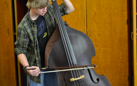 Spencer Becker plays both electric and upright bass