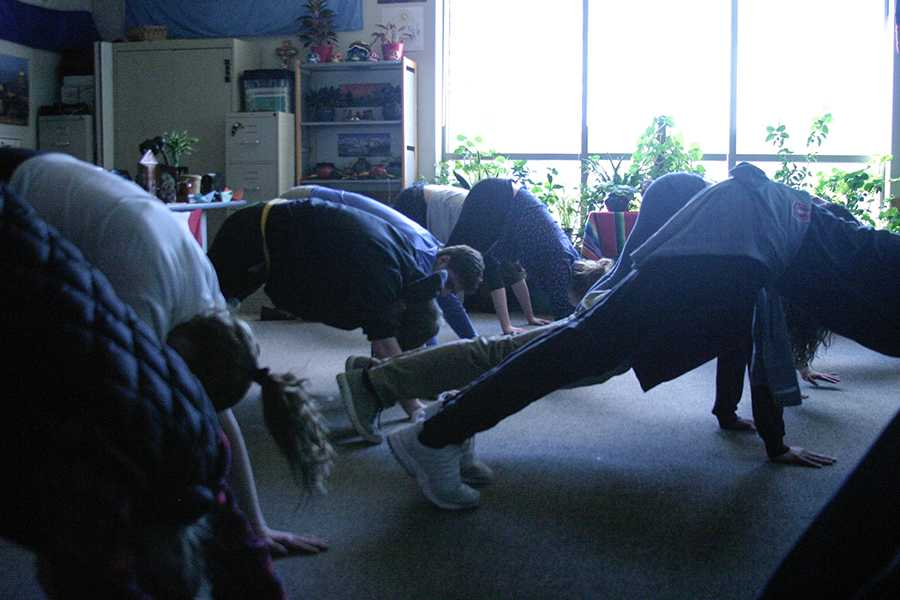 Another station involved yoga with French teacher Ms. Frederique Toft, who led students in a sun salutation.