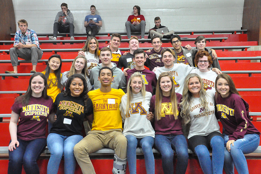 At+the+breakfast%2C+seniors+had+the+chance+to+take+photos+with+their+classmates+in+their+college+t-shirts.