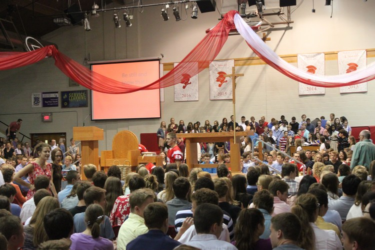 The student body surrounds the stage.