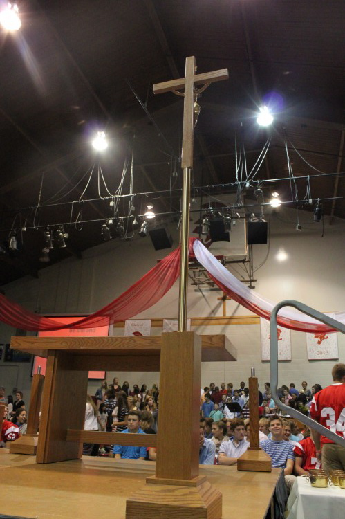 The cross stands high on the newly raised stage at Mass.