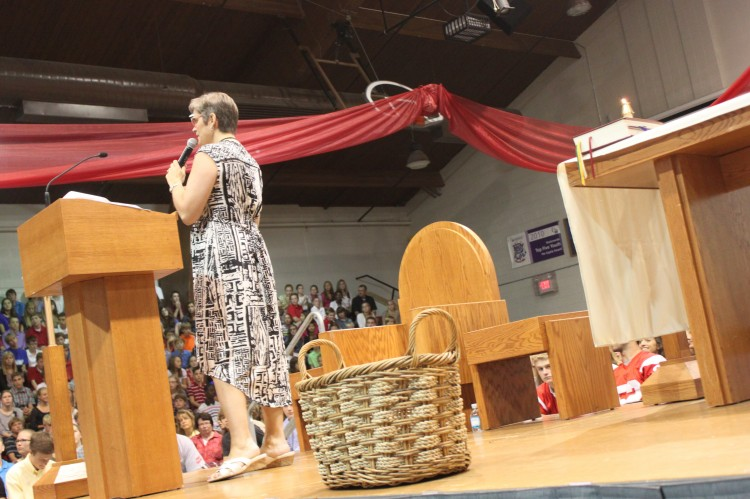 Principal Sue Skinner gives speech to student body after Mass has concluded.