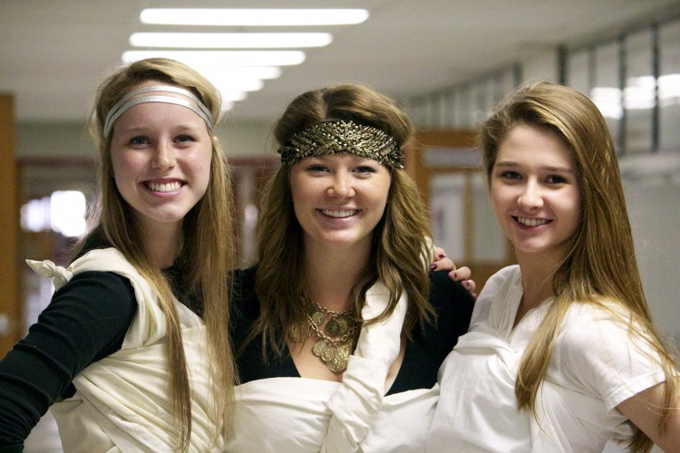 Seniors Abby Dryer, Sammi Johnson, and Mary Alice Hutton pose in their homemade togas on