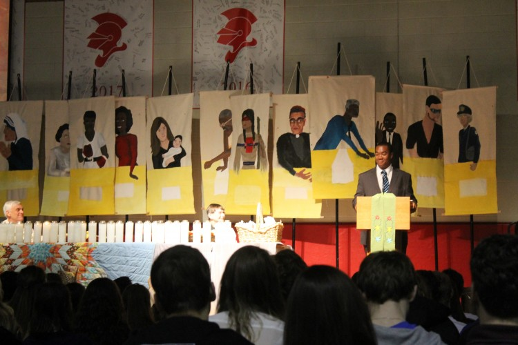 Students painted canvases of modern-day saints which were displayed behind the main table where the presiders of the prayer service sat.