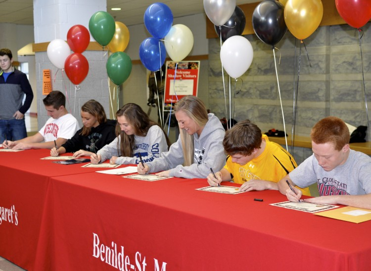 Five seniors officially signed to Division I teams for their respective sports. Soccer player Dana Buckhorn, pictured second from left, will not officially sign until this spring, but was included in the ceremony with her fellow athletes.