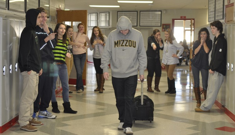Because of his back surgery, junior Will Jarvis has been forced to use a roller backpack, losing all of the street cred he's built up over the years.