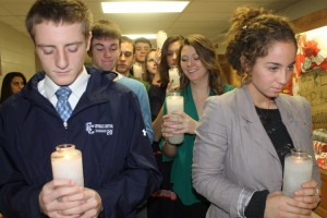Students carry in candles in preparation for the Thanksgiving prayer service.