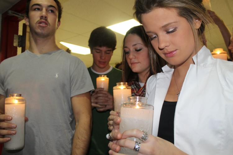 Seniors lined up in the hallway before they processed in with candles at the beginning of the service.