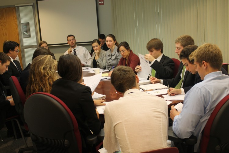 AP Government students gather around a traditional round table for annual mock cabinet meeting.
