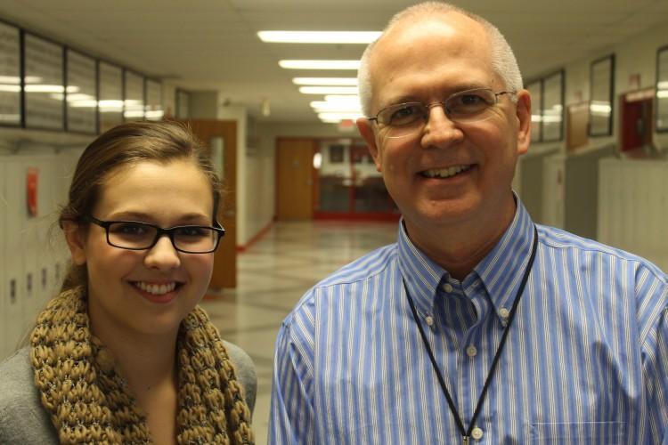 Senior Jenny Krane discusses new movies with English teacher Mr. Tom Backen.