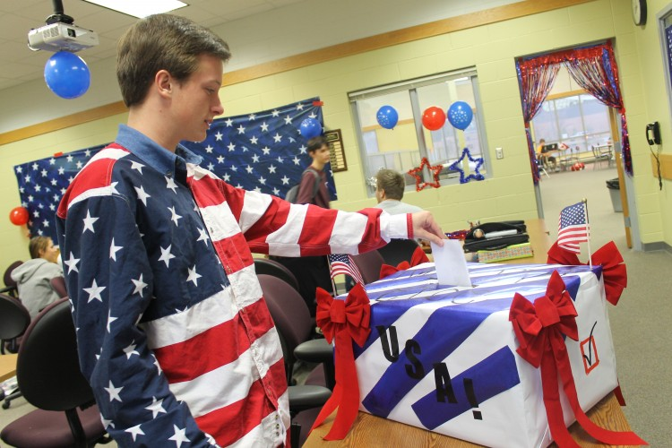 Jack Tucker casts his vote in the mock election in the Library Conference room.