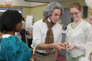 Seniors, Andrew Phaff and Precious Walker, participate in the AP European History classs Enlightenment Salon.