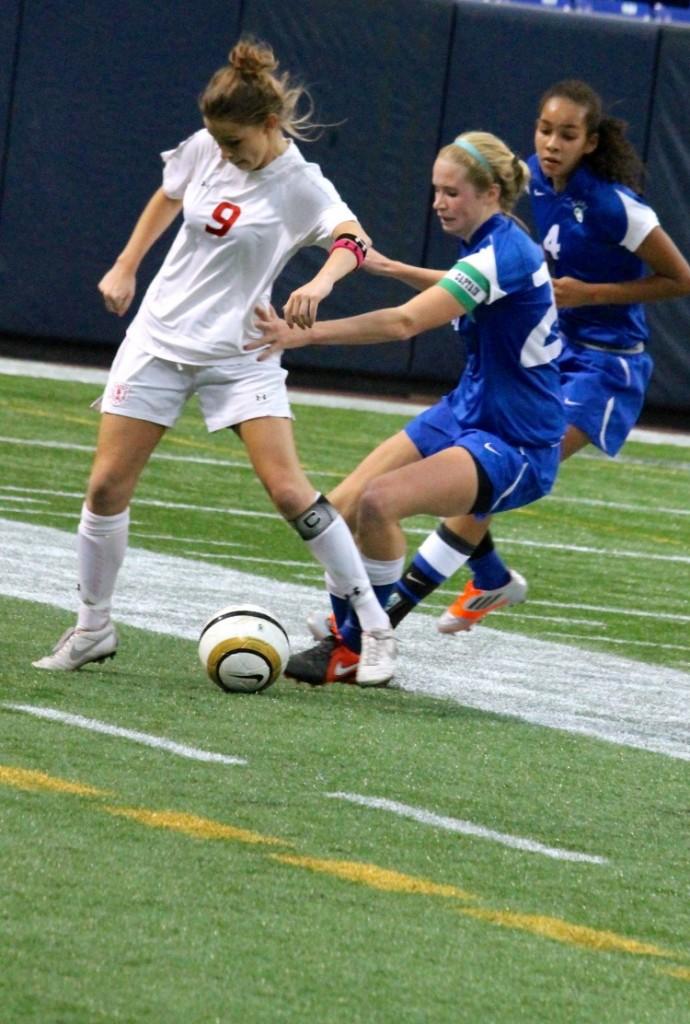 Senior forward Dana Buckhorn fights to weasel the ball away from Blake player Hannah Randolph.