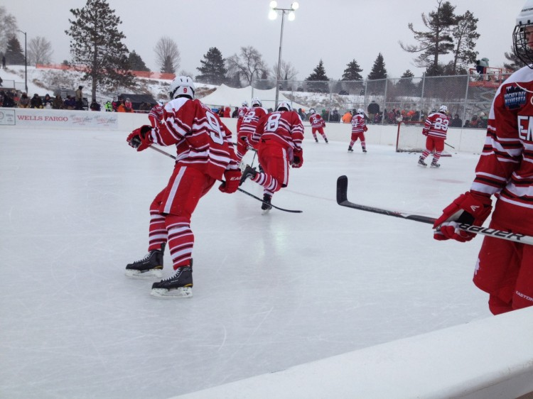 Red Knight players warm up outside in their 1959 throwback uniforms