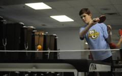 Varsity player Danny Hogan practices his ping-pong skills during practice against other BSM students.