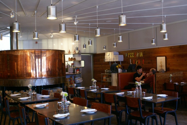 The+copper%2C+wood-fired+oven+is+featured+prominently+at+Ann+Kim%E2%80%99s+popular+Pizzeria+Lola.