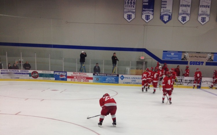 Senior captain Daniel Labosky takes a moment on the ice at the end of the game after losing to St. Thomas Academy 3-1.