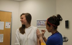 Students all throughout the metro area have been suffering through flu shots in hopes of staving off infection.