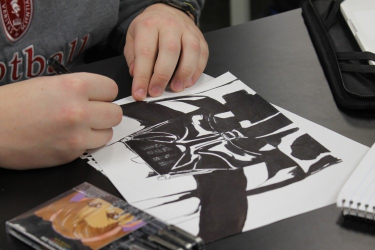 Junior Jeremy Pastir demonstrates his artistic talent through his drawings.