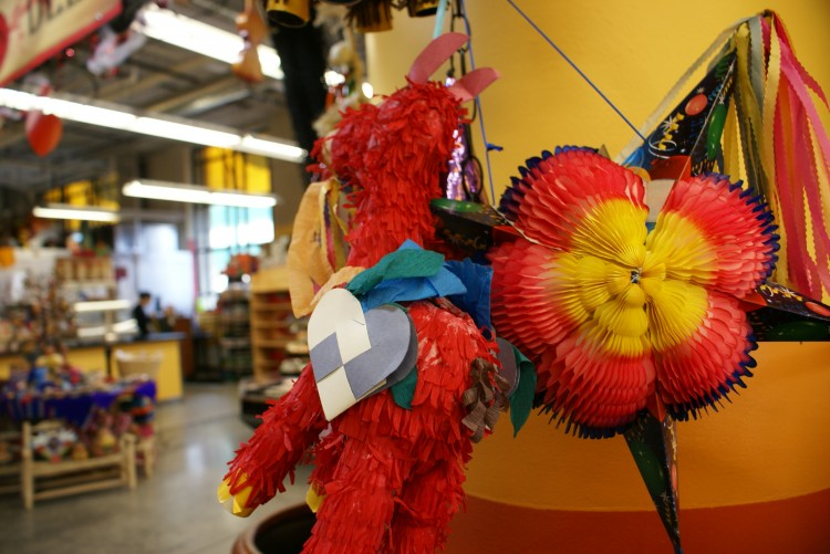 A piñata decorates the  entrance of El Burrito Mercado.