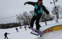 Seniors with snowboarding hobby take advantage of snow