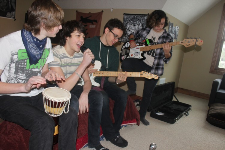 The band practices their set list for an upcoming gig.