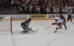 Senior Chris Hickock takes a shot during a breakaway play.