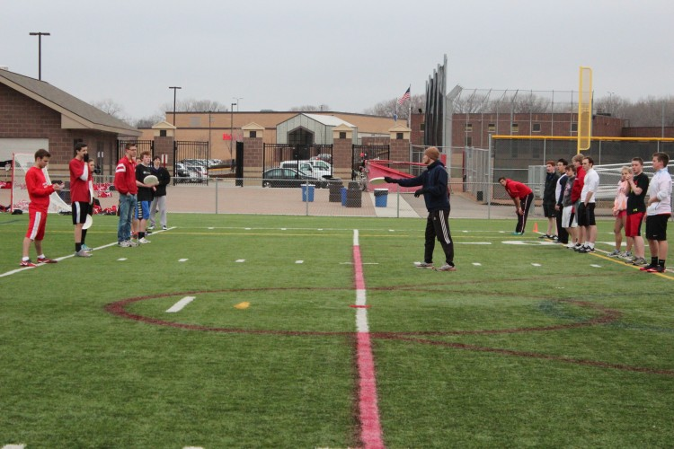 The 30 member ultimate team practice on the field to prepare for the upcoming season.