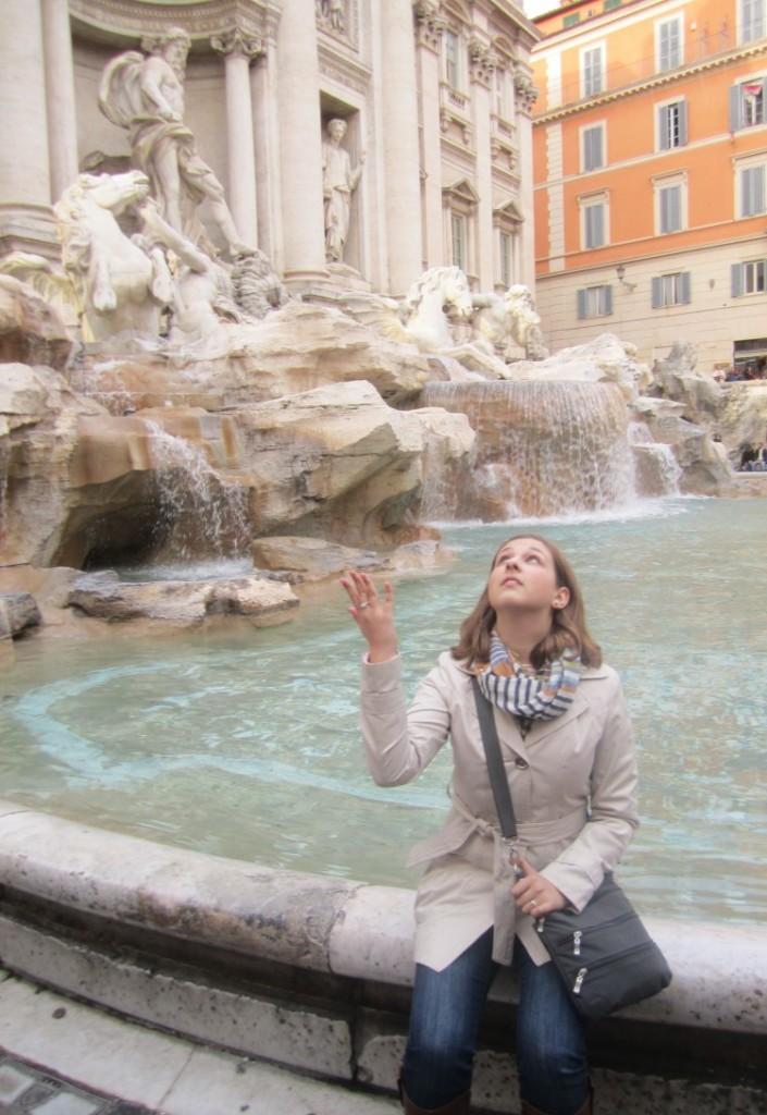 Senior Jenny Krane tosses a coin into the Trevi Fountain.