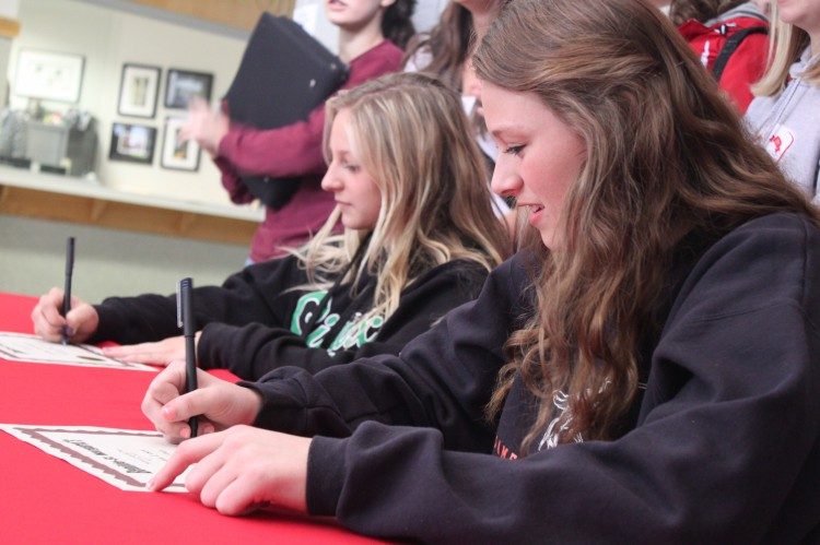 Seniors Rachel Thorstenson and Emma Lysne signed their letters of intent to play college athletics.
