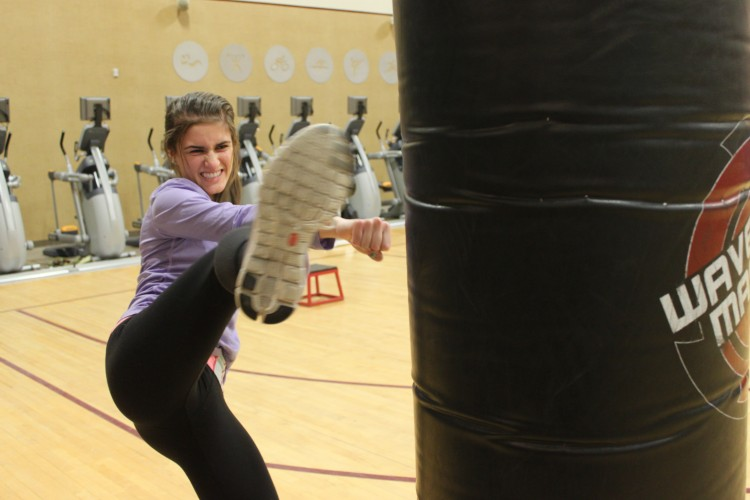 Students, like senior Kaitlin Duda, work out through classes and opportunities at local fitness centers.