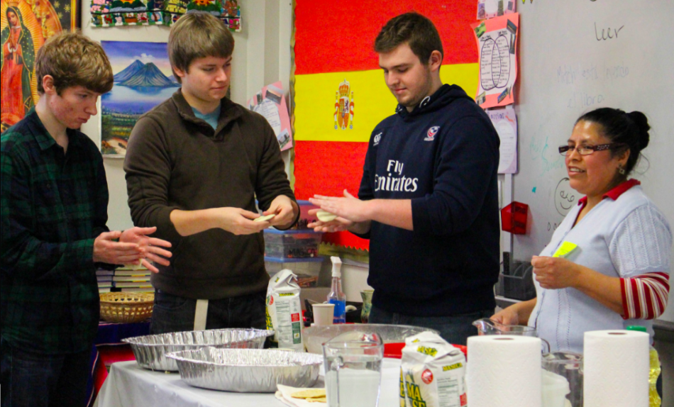 Juniors Griffen Anderson and Austin Bray, along with sophomore James Libbey, participate in tortilla-making in their Spanish class. This activity, along with many others for each World Language, was arranged in order to make students more aware of cultures outside America.