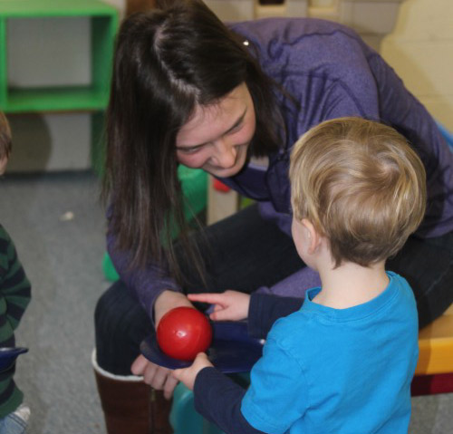 Senior Zoe Cave, one of three students who volunteer weekly with the Little Knights, plays with the kids, helps set up activities, helps clean up and forms close relationships with each of them.