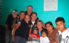 The Melin family visited with a family during their travels to Flores De Villa, Peru, last summer. Their trip included aiding their church in building homes for struggling Peruvians.