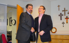 Current president Dr. Bob Tift and future president Dr. Kevin Gyolai shake hands. Dr. Gyolai will begin his duties on July 1, 2014, leading the BSM community after years working as the Dean of STEM at Inver Hills Community College.