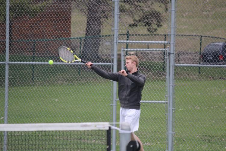 Peter Heimbold volleys during a mid-season match against Hopkins.