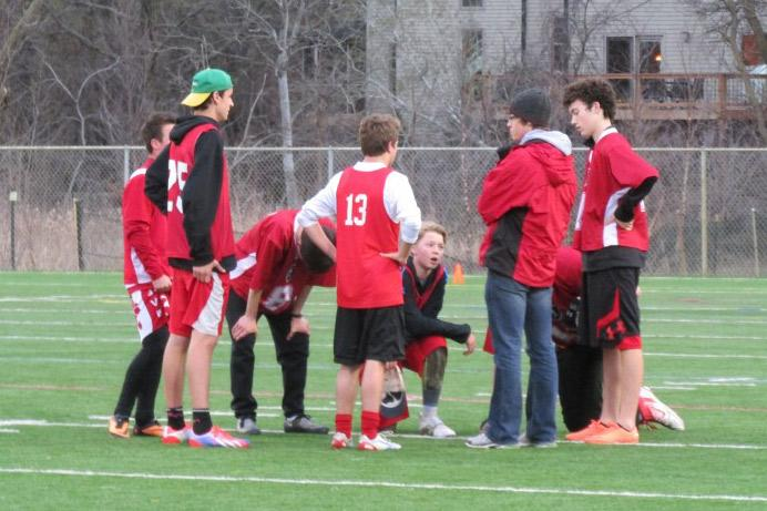 The+BSM+Red+Knights+huddle+during+a+game+as+senior+captians+Jonathan+Paquette+and+Drew+Coulombe+motivate+the+X+team.+There+are+two+teams+this+year%2C+the+X+and+Y+teams%2C+which+are+led+by+two+senior+captains+each.+Y+team+captains+are+Matt+Wolf+and+Mack+Nevells.