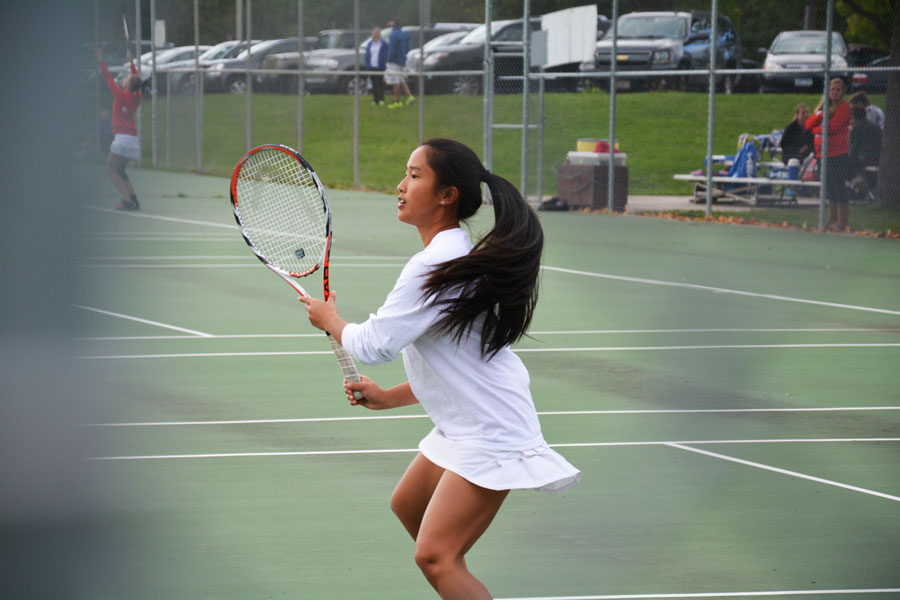 Junior+Elly+Amighi+prepares+to+hit+a+return+shot+in+a+crucial+match.