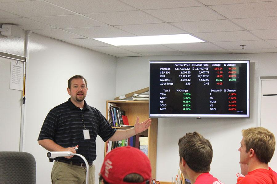 Students use Mr. Sabol's new stock ticker to check their investments.