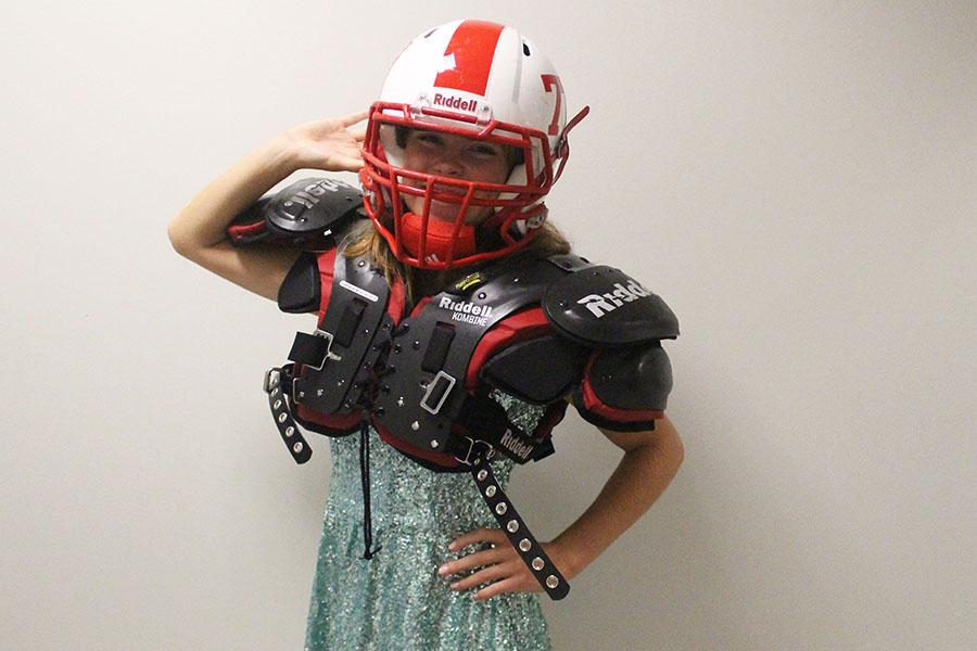 Football+enthusiast+and+first-round+pick%2C+Sofie+Madden+models+her+homecoming+dress+and+pads.