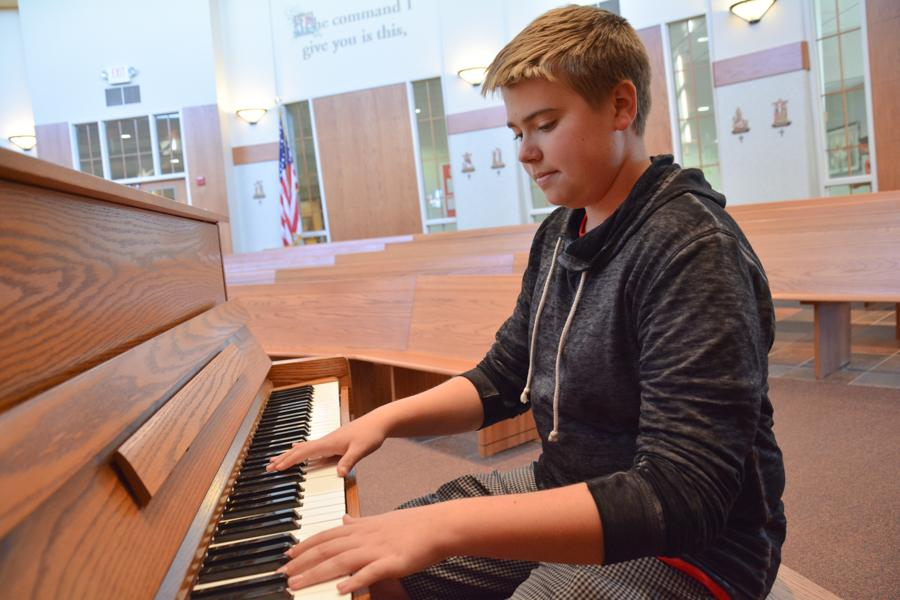Sophomore+Chaz+Linder%2C+who+has+been+playing+the+piano+since+age+four%2C+wowed+the+BSM+student+body+with+his+composition+at+mass.