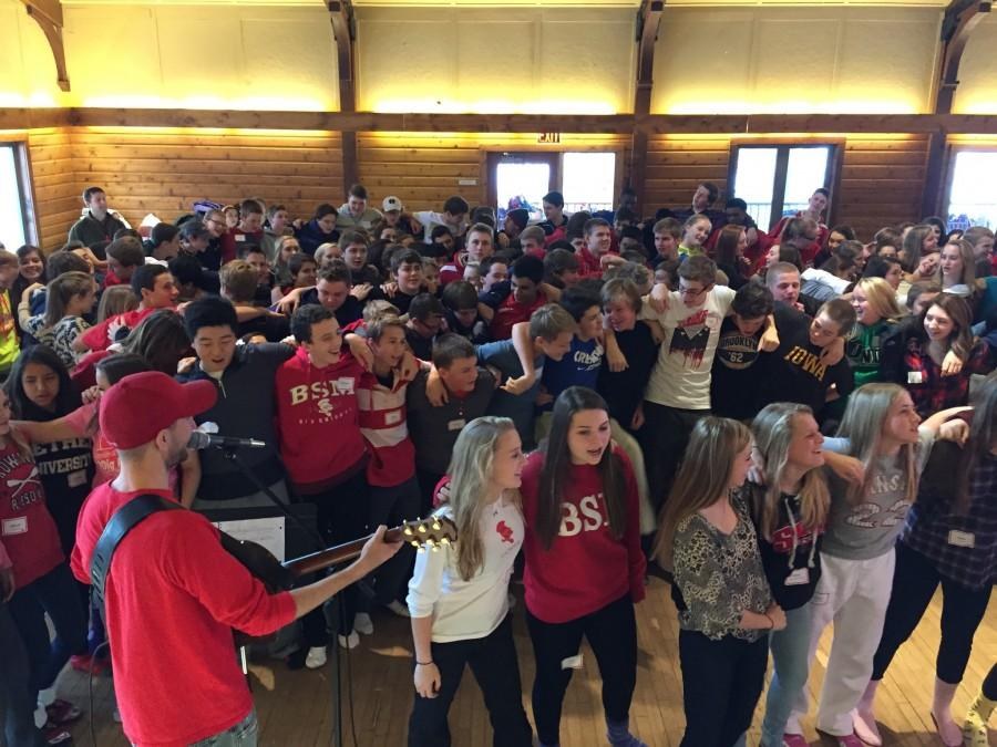 Freshmen+participate+in+a+sing-a-long+led+by+religion+teacher+Mr.+Schmidt.